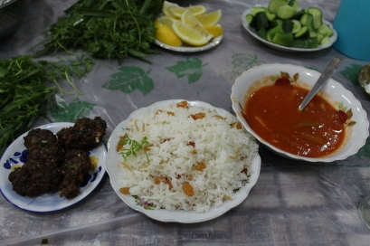 Dinner: shufte (meatballs), brinj (rice), shillay bazam (okra soup), and garnish (anise, parsley, lemon, and cucumber).