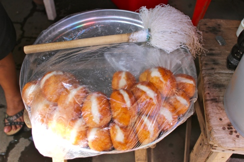 "Relámpagos! Literally: lightnings. Sweet fried rolls filled with atol (maize and sugar pudding). I asked the seller why they are called ""lightnings"" and she responded, ""because that's what they're called."""