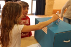 11-year old Hodaya, putting her mother's ballot in the box.